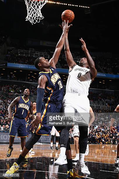 Andray Blatche of the Brooklyn Nets shoots against Ian Mahinmi of the Indiana Pacers during a game at the Barclays Center on December 23 2013 in the...