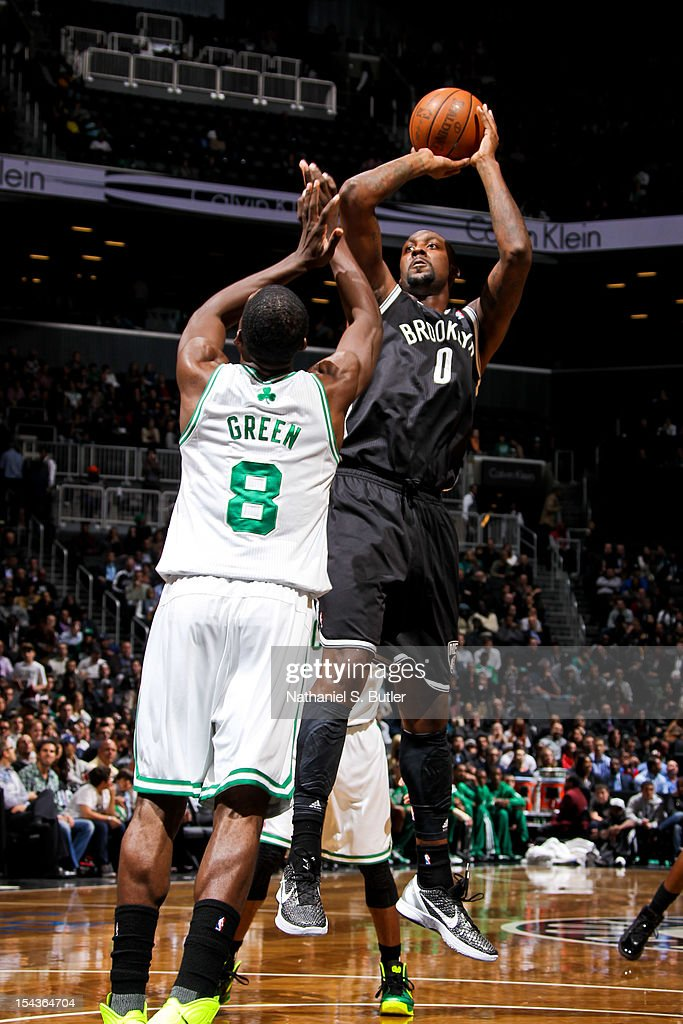 Andray Blatche #0 of the Brooklyn Nets shoots against Jeff Green #8 of the Boston Celtics during a pre-season game on October 18, 2012 at the Barclays Center in the Brooklyn borough of New York City.