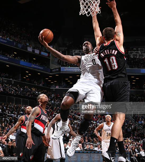 Andray Blatche of the Brooklyn Nets shoots against Joel Freeland of the Portland Trail Blazers during a game at Barclays Center on November 18 2013...
