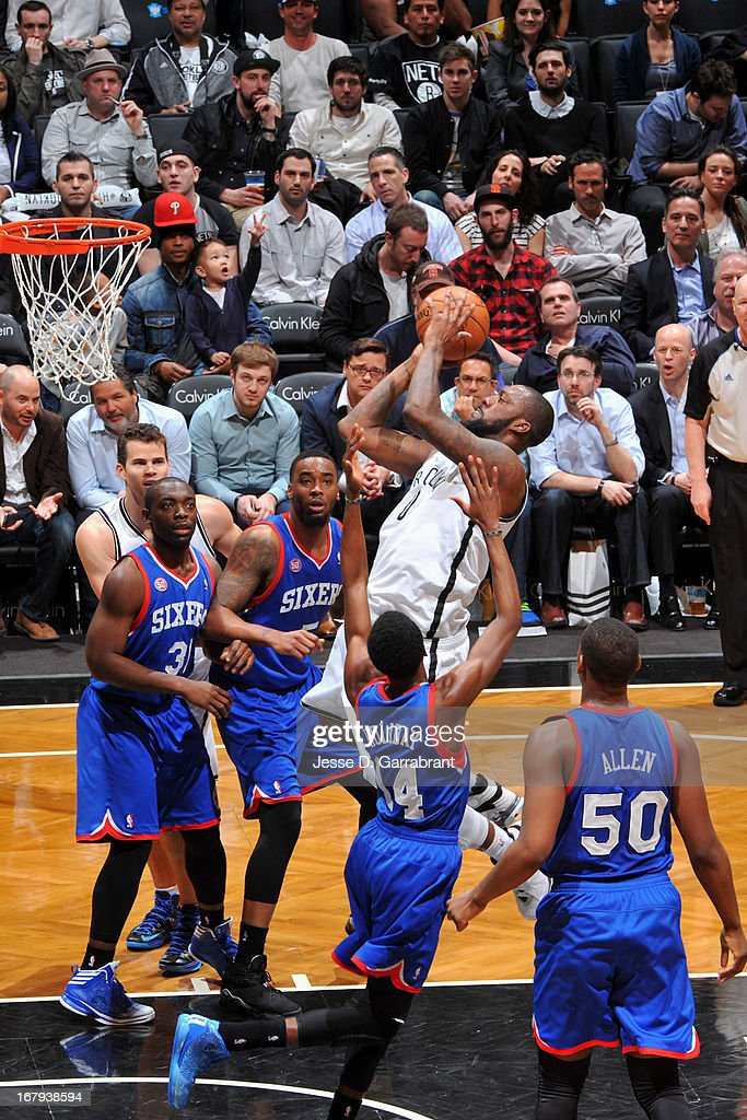 <a gi-track='captionPersonalityLinkClicked' href=/galleries/search?phrase=Andray+Blatche&family=editorial&specificpeople=4282797 ng-click='$event.stopPropagation()'>Andray Blatche</a> #0 of the Brooklyn Nets shoots against Justin Holiday #14 of the Philadelphia 76ers on April 9, 2013 at the Barclays Center in Brooklyn, New York.