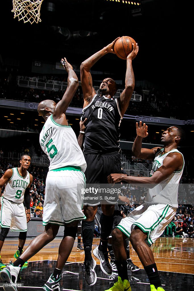 Andray Blatche #0 of the Brooklyn Nets shoots against Kevin Garnett #5 of the Boston Celtics during a pre-season game on October 18, 2012 at the Barclays Center in the Brooklyn borough of New York City.