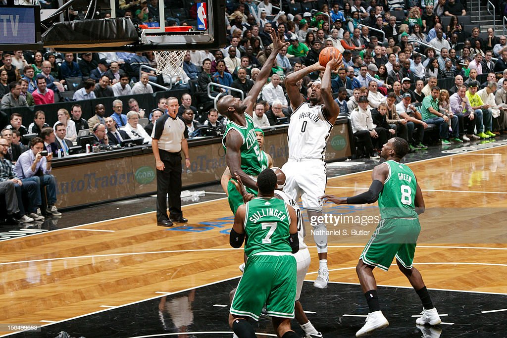 Andray Blatche #0 of the Brooklyn Nets shoots against Kevin Garnett #5 of the Boston Celtics on November 15, 2012 at the Barclays Center in the Brooklyn borough of New York City.