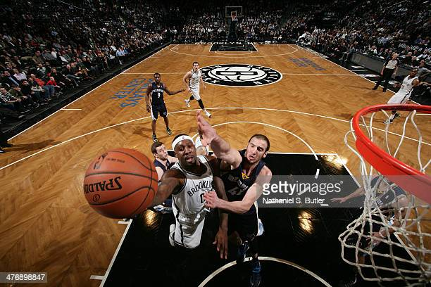 Andray Blatche of the Brooklyn Nets shoots against Kosta Koufos of the Memphis Grizzlies at the Barclays Center on March 5 2014 in the Brooklyn...