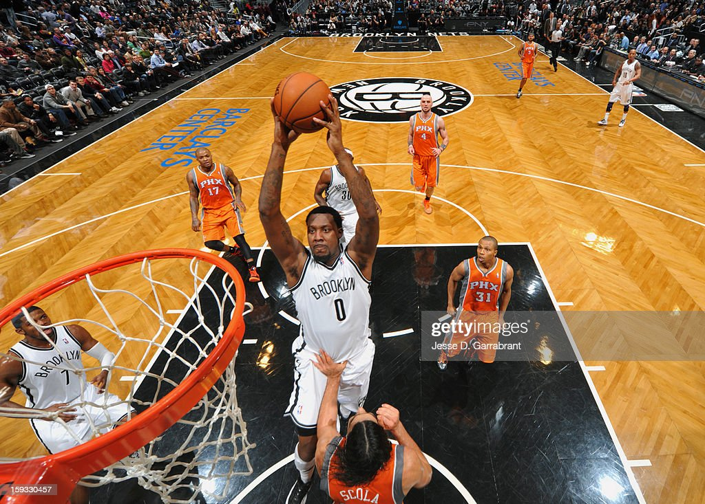 Andray Blatche #0 of the Brooklyn Nets shoots against Luis Scola #14 of the Phoenix Suns during the game at the Barclays Center on January 11, 2013 in Brooklyn, New York.