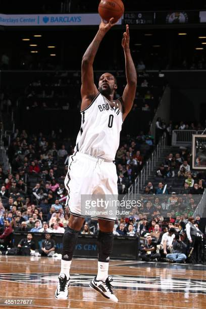Andray Blatche of the Brooklyn Nets shoots against the Boston Celtics at Barclays Center on December 10 2013 in the Brooklyn borough of New York City...