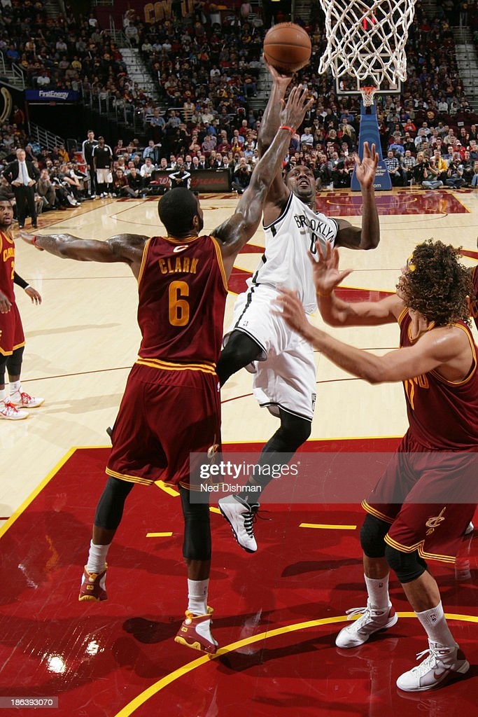 <a gi-track='captionPersonalityLinkClicked' href=/galleries/search?phrase=Andray+Blatche&family=editorial&specificpeople=4282797 ng-click='$event.stopPropagation()'>Andray Blatche</a> #0 of the Brooklyn Nets shoots against the Cleveland Cavaliers during a game at the Quicken Loans Arena on October 30, 2013 in Cleveland, Ohio.