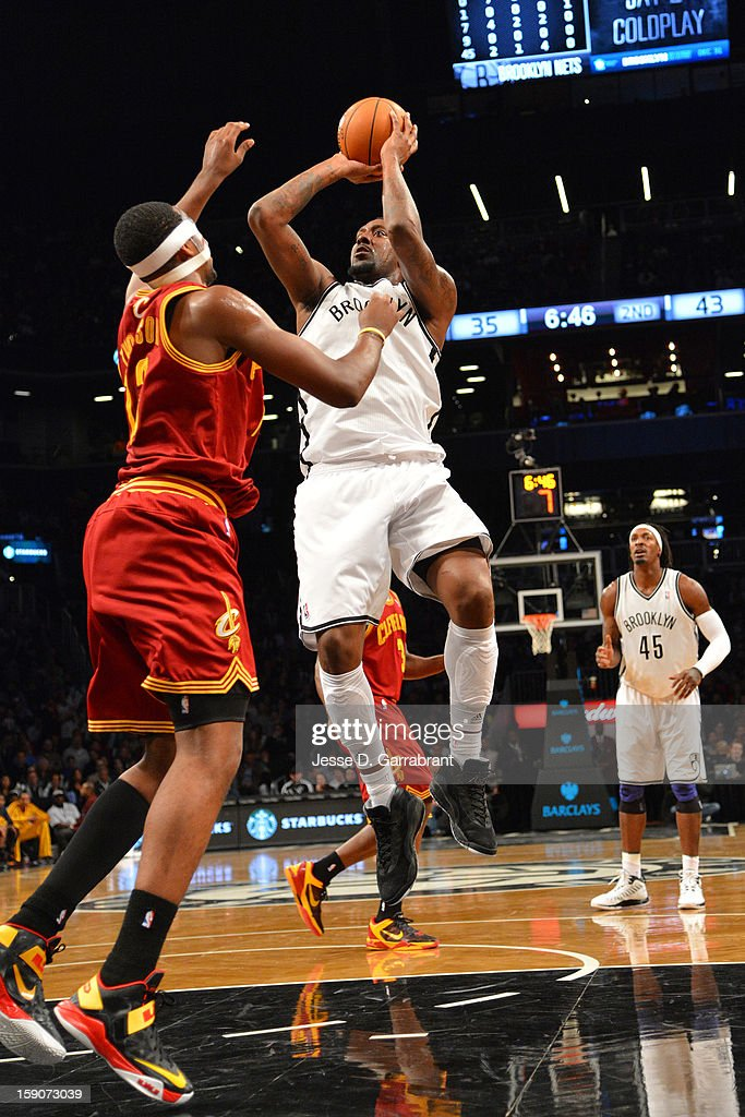 <a gi-track='captionPersonalityLinkClicked' href=/galleries/search?phrase=Andray+Blatche&family=editorial&specificpeople=4282797 ng-click='$event.stopPropagation()'>Andray Blatche</a> #0 of the Brooklyn Nets shoots against the Cleveland Cavaliers at the Barclays Center on December 29, 2012 in Brooklyn, New York.