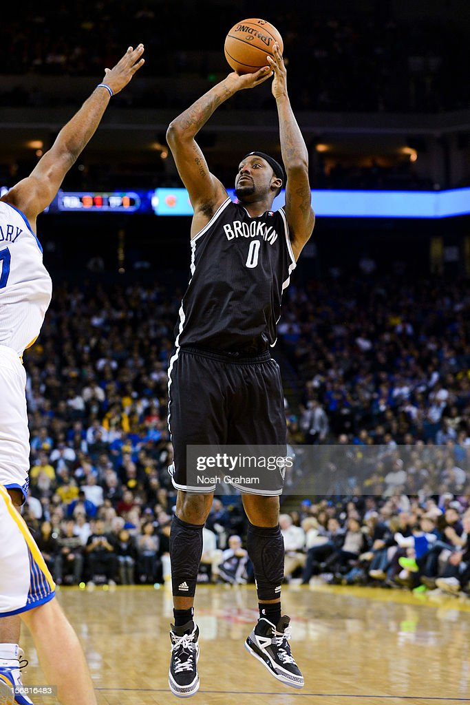 <a gi-track='captionPersonalityLinkClicked' href=/galleries/search?phrase=Andray+Blatche&family=editorial&specificpeople=4282797 ng-click='$event.stopPropagation()'>Andray Blatche</a> #0 of the Brooklyn Nets shoots against the Golden State Warriors at Oracle Arena on November 21, 2012 in Oakland, California.