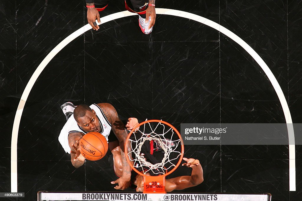 <a gi-track='captionPersonalityLinkClicked' href=/galleries/search?phrase=Andray+Blatche&family=editorial&specificpeople=4282797 ng-click='$event.stopPropagation()'>Andray Blatche</a> #0 of the Brooklyn Nets shoots against the Miami Heat during Game Three of the Eastern Conference Semifinals on May 10, 2014 at Barclays Center in Brooklyn.