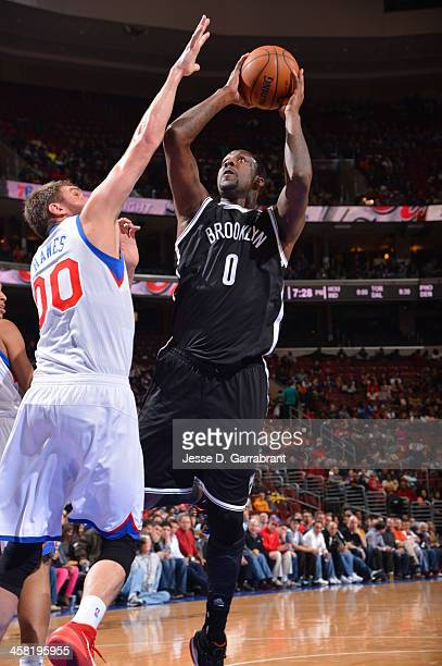 Andray Blatche of the Brooklyn Nets shoots against the Philadelphia 76ers at the Wells Fargo Center on December 20 2013 in Philadelphia Pennsylvania...