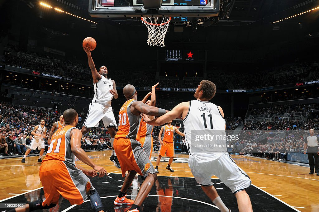 Andray Blatche #0 of the Brooklyn Nets shoots against the Phoenix Suns during the game at the Barclays Center on January 11, 2013 in Brooklyn, New York.