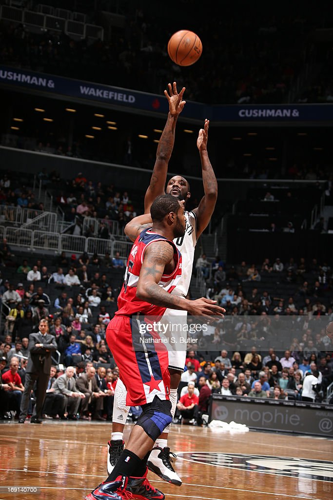 Andray Blatche #0 of the Brooklyn Nets shoots against Trevor Booker #35 of the Washington Wizards on April 15, 2013 at the Barclays Center in the Brooklyn borough of New York City.