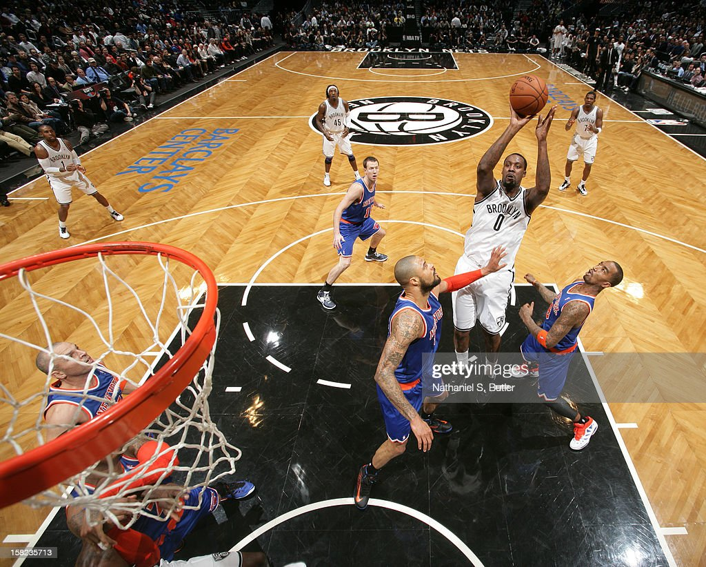 Andray Blatche #0 of the Brooklyn Nets shoots against Tyson Chandler #6 and J.R. Smith #8 of the New York Knicks on December 11, 2012 at the Barclays Center in the Brooklyn borough of New York City.