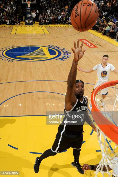 Andray Blatche of the Brooklyn Nets shoots during a game against the Golden State Warriors at Oracle Arena on February 22 2014 in Oakland California...