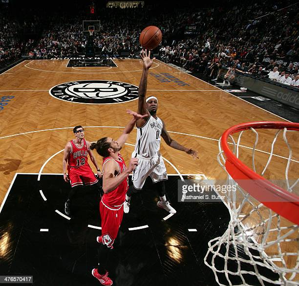 Andray Blatche of the Brooklyn Nets shoots over Joakim Noah of the Chicago Bulls during a game at the Barclays Center on March 3 2014 in the Brooklyn...