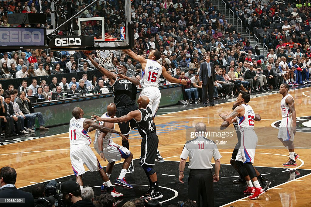 Andray Blatche #0 of the Brooklyn Nets shoots over Ryan Hollins #15 of the Los Angeles Clippers on November 23, 2012 at the Barclays Center in the Brooklyn Borough of New York City.