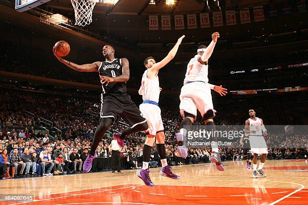 Andray Blatche of the Brooklyn Nets shoots past Andrea Bargnani and Carmelo Anthony of the New York Knicks during a game at Madison Square Garden in...