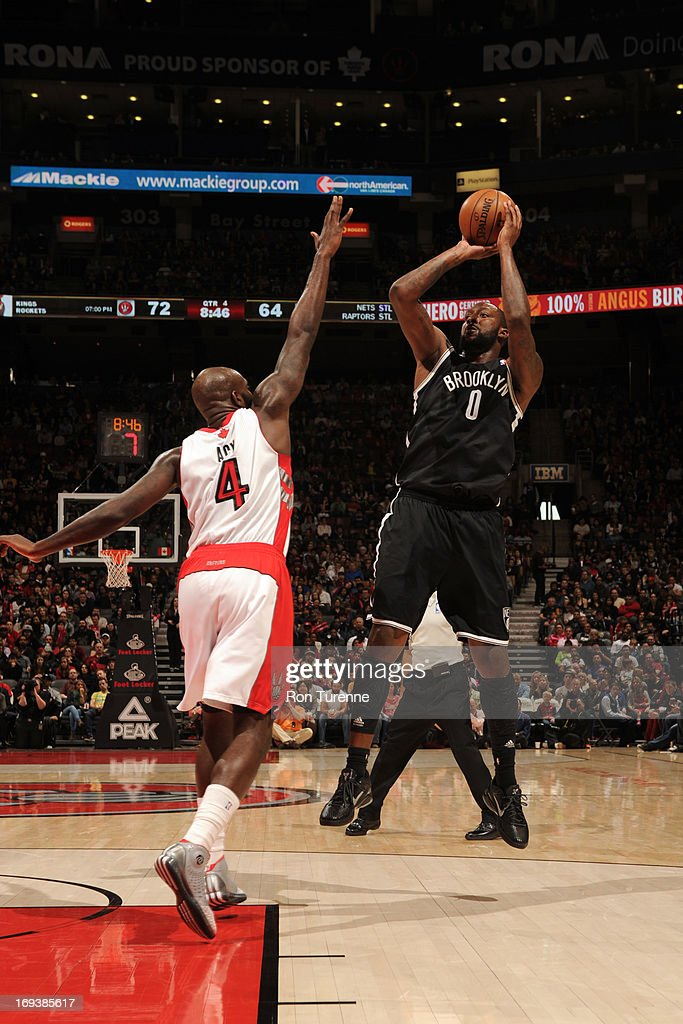 <a gi-track='captionPersonalityLinkClicked' href=/galleries/search?phrase=Andray+Blatche&family=editorial&specificpeople=4282797 ng-click='$event.stopPropagation()'>Andray Blatche</a> #0 of the Brooklyn Nets shoots the ball against the Toronto Raptors during the game on April 14, 2013 at the Air Canada Centre in Toronto, Ontario, Canada.