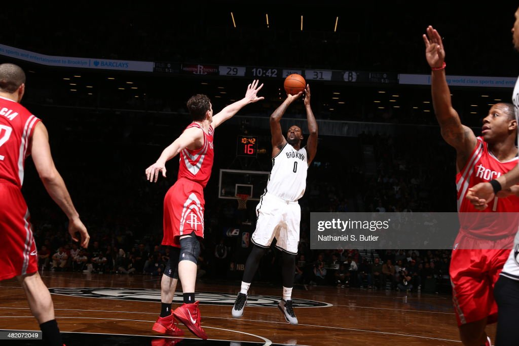 <a gi-track='captionPersonalityLinkClicked' href=/galleries/search?phrase=Andray+Blatche&family=editorial&specificpeople=4282797 ng-click='$event.stopPropagation()'>Andray Blatche</a> #0 of the Brooklyn Nets shoots the ball during the game against the Houston Rockets at the Barclays Center on April 01, 2014 in the Brooklyn borough of New York City.