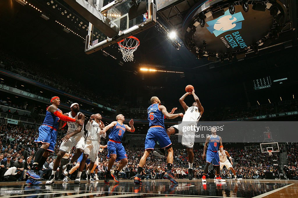 Andray Blatche #0 of the Brooklyn Nets takes a shot against the New York Knicks on December 11, 2012 at the Barclays Center in the Brooklyn borough of New York City.