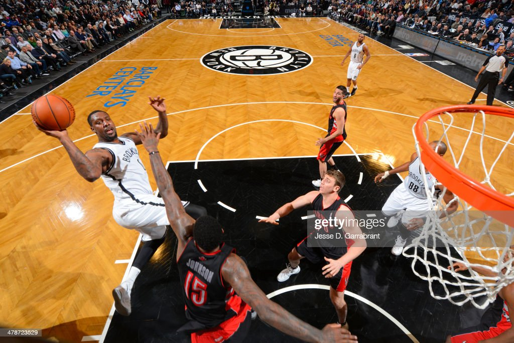 <a gi-track='captionPersonalityLinkClicked' href=/galleries/search?phrase=Andray+Blatche&family=editorial&specificpeople=4282797 ng-click='$event.stopPropagation()'>Andray Blatche</a> #0 of the Brooklyn Nets takes a shot against the Toronto Raptors on March 10, 2014 at the Barclays Center in Brooklyn, New York.