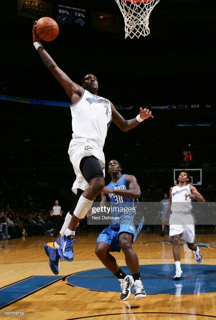 <a gi-track='captionPersonalityLinkClicked' href=/galleries/search?phrase=Andray+Blatche&family=editorial&specificpeople=4282797 ng-click='$event.stopPropagation()'>Andray Blatche</a> #7 of the Washington Wizards dunks against <a gi-track='captionPersonalityLinkClicked' href=/galleries/search?phrase=Brandon+Bass&family=editorial&specificpeople=233806 ng-click='$event.stopPropagation()'>Brandon Bass</a> #30 of the Orlando Magic at the Verizon Center on November 27, 2010 in Washington, DC.