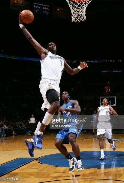 Andray Blatche of the Washington Wizards dunks against Brandon Bass of the Orlando Magic at the Verizon Center on November 27 2010 in Washington DC...