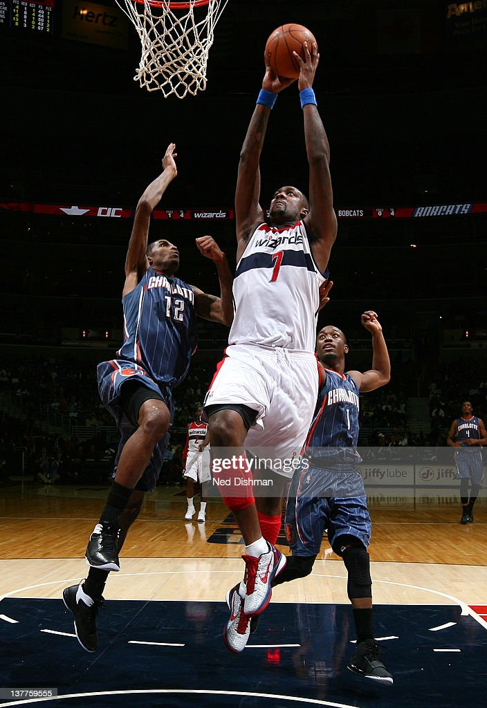 <a gi-track='captionPersonalityLinkClicked' href=/galleries/search?phrase=Andray+Blatche&family=editorial&specificpeople=4282797 ng-click='$event.stopPropagation()'>Andray Blatche</a> #7 of the Washington Wizards dunks against <a gi-track='captionPersonalityLinkClicked' href=/galleries/search?phrase=Tyrus+Thomas&family=editorial&specificpeople=453285 ng-click='$event.stopPropagation()'>Tyrus Thomas</a> #12 and <a gi-track='captionPersonalityLinkClicked' href=/galleries/search?phrase=Kemba+Walker&family=editorial&specificpeople=5042442 ng-click='$event.stopPropagation()'>Kemba Walker</a> #1 of the Charlotte Bobcats during the game at the Verizon Center on January 25, 2012 in Washington, DC.