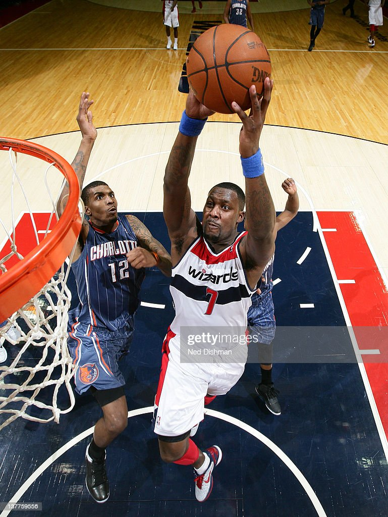 <a gi-track='captionPersonalityLinkClicked' href=/galleries/search?phrase=Andray+Blatche&family=editorial&specificpeople=4282797 ng-click='$event.stopPropagation()'>Andray Blatche</a> #7 of the Washington Wizards dunks against <a gi-track='captionPersonalityLinkClicked' href=/galleries/search?phrase=Tyrus+Thomas&family=editorial&specificpeople=453285 ng-click='$event.stopPropagation()'>Tyrus Thomas</a> #12 of the Charlotte Bobcats during the game at the Verizon Center on January 25, 2012 in Washington, DC.