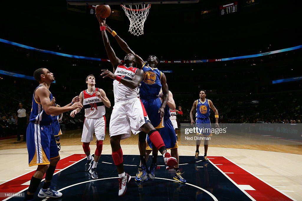 <a gi-track='captionPersonalityLinkClicked' href=/galleries/search?phrase=Andray+Blatche&family=editorial&specificpeople=4282797 ng-click='$event.stopPropagation()'>Andray Blatche</a> #7 of the Washington Wizards goes to the basket against <a gi-track='captionPersonalityLinkClicked' href=/galleries/search?phrase=Ekpe+Udoh&family=editorial&specificpeople=4185351 ng-click='$event.stopPropagation()'>Ekpe Udoh</a> #20 of the Golden State Warriors during the game between the Washington Wizards and the Golden State Warriors at the Verizon Center on March 5, 2012 in Washington, DC.