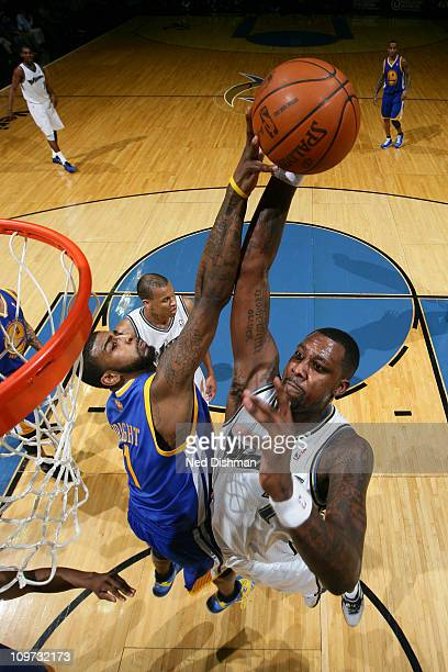Andray Blatche of the Washington Wizards has his shot attempt blocked by Dorell Wright of the Golden State Warriors at the Verizon Center on March 2...