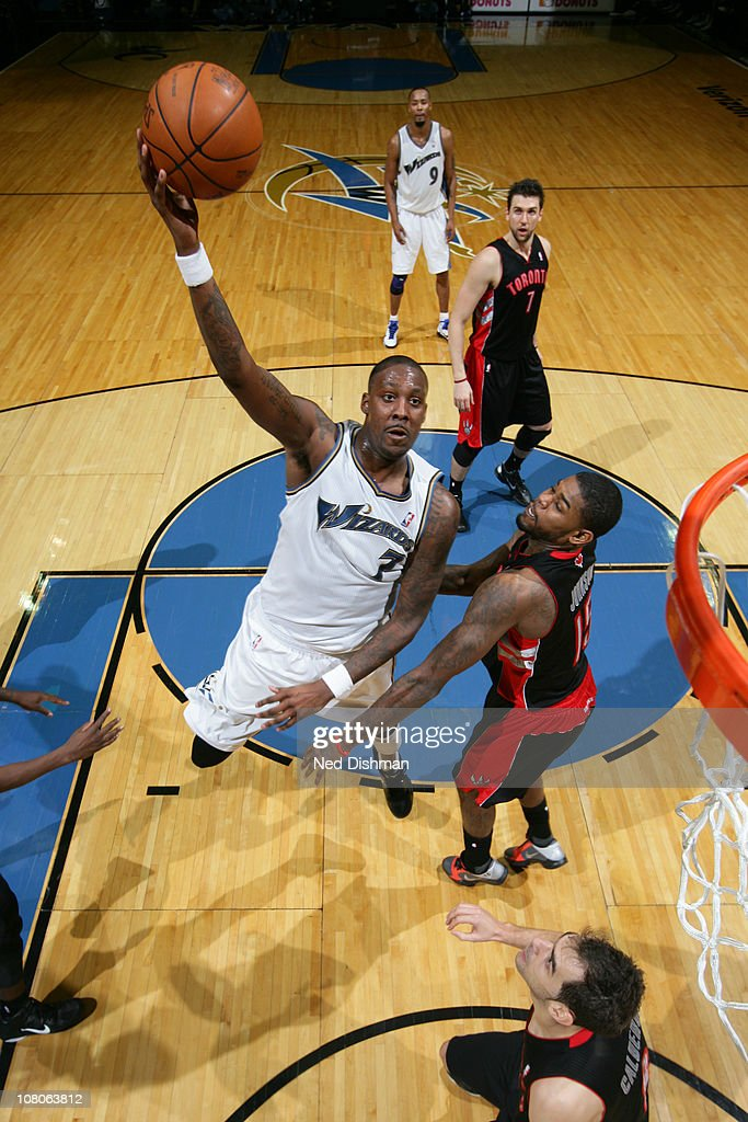 <a gi-track='captionPersonalityLinkClicked' href=/galleries/search?phrase=Andray+Blatche&family=editorial&specificpeople=4282797 ng-click='$event.stopPropagation()'>Andray Blatche</a> #7 of the Washington Wizards shoots against <a gi-track='captionPersonalityLinkClicked' href=/galleries/search?phrase=Amir+Johnson&family=editorial&specificpeople=556786 ng-click='$event.stopPropagation()'>Amir Johnson</a> #15 of the Toronto Raptors at the Verizon Center on January 15, 2011 in Washington, DC.