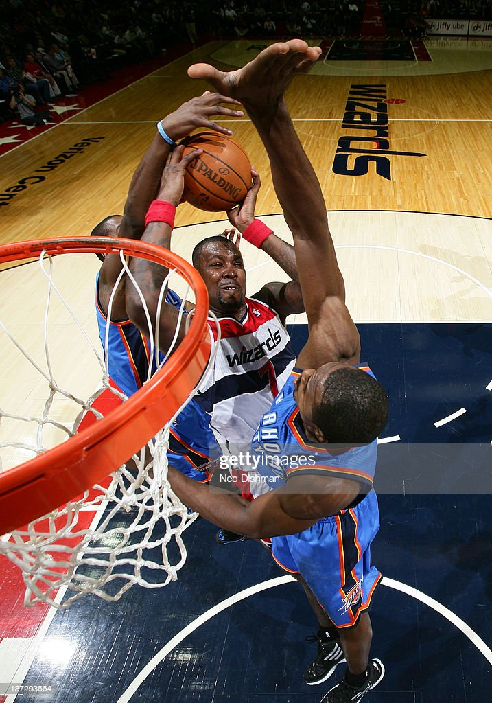 <a gi-track='captionPersonalityLinkClicked' href=/galleries/search?phrase=Andray+Blatche&family=editorial&specificpeople=4282797 ng-click='$event.stopPropagation()'>Andray Blatche</a> #7 of the Washington Wizards shoots against Kendrick Perkins #5 of the Oklahoma City Thunder during the game at the Verizon Center on January 18, 2012 in Washington, DC.