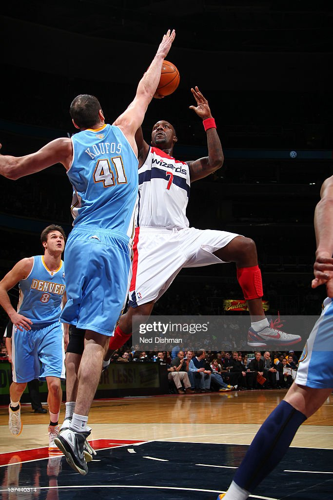 <a gi-track='captionPersonalityLinkClicked' href=/galleries/search?phrase=Andray+Blatche&family=editorial&specificpeople=4282797 ng-click='$event.stopPropagation()'>Andray Blatche</a> #7 of the Washington Wizards shoots against <a gi-track='captionPersonalityLinkClicked' href=/galleries/search?phrase=Kosta+Koufos&family=editorial&specificpeople=4216032 ng-click='$event.stopPropagation()'>Kosta Koufos</a> #41 of the Denver Nuggets during the game at the Verizon Center on January 20, 2012 in Washington, DC.