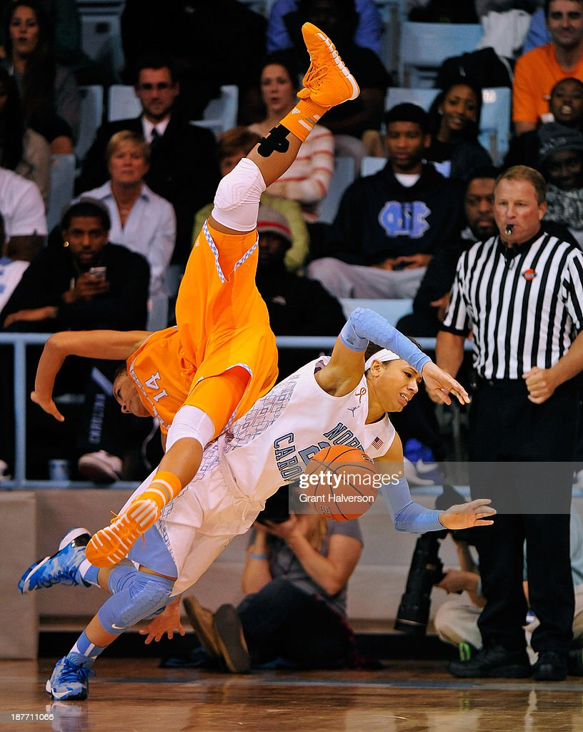 Andraya Carter of the Tennessee Lady Vols flips over Jessica Washington of the North Carolina Tar Heels during play at Carmichael Arena on November...