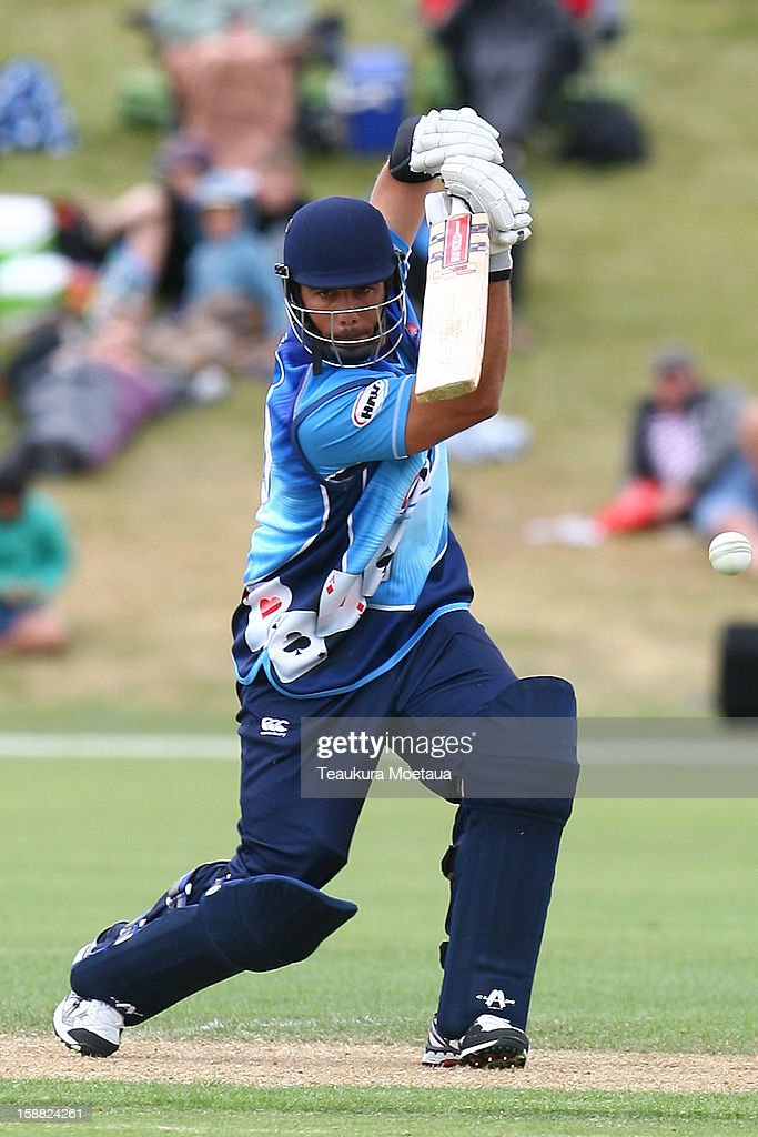 <a gi-track='captionPersonalityLinkClicked' href=/galleries/search?phrase=Andre+Adams&family=editorial&specificpeople=795802 ng-click='$event.stopPropagation()'>Andre Adams</a> of Auckland hits to the onside during the Twenty20 match between Otago and Auckland at Queenstown Events Centre on December 31, 2012 in Queenstown, New Zealand.