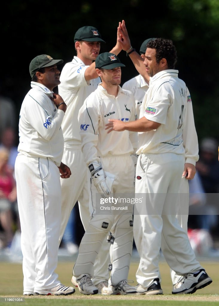 Andre Adams of Nottinghamshire is congratulated by teammates after taking the wicket of Tom Smith of Lancashire during the LV County Championship...