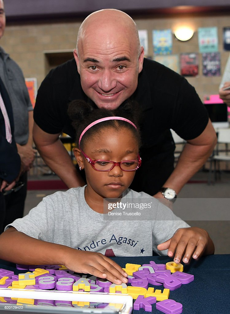 Andre Agassi and a student during a press conference to announce a special partnership and research project with Square Panda and the Andre Agassi College Preparatory Academy on November 1, 2016 in Las Vegas, Nevada.