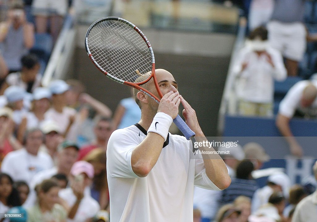<a gi-track='captionPersonalityLinkClicked' href=/galleries/search?phrase=Andre+Agassi&family=editorial&specificpeople=157607 ng-click='$event.stopPropagation()'>Andre Agassi</a> defeats <a gi-track='captionPersonalityLinkClicked' href=/galleries/search?phrase=Jiri+Novak&family=editorial&specificpeople=210775 ng-click='$event.stopPropagation()'>Jiri Novak</a> in the third round of the men's singles September 4, 2004 at the 2004 US Open in New York.