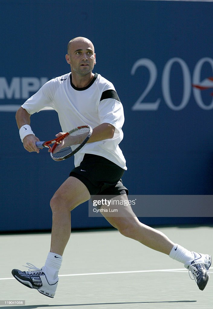 <a gi-track='captionPersonalityLinkClicked' href=/galleries/search?phrase=Andre+Agassi&family=editorial&specificpeople=157607 ng-click='$event.stopPropagation()'>Andre Agassi</a> during his second round match against <a gi-track='captionPersonalityLinkClicked' href=/galleries/search?phrase=Florian+Mayer&family=editorial&specificpeople=206516 ng-click='$event.stopPropagation()'>Florian Mayer</a> at the 2004 US Open in the USTA National Tennis Center in New York on September 2, 2004. Agassi won the match after Mayer retired.