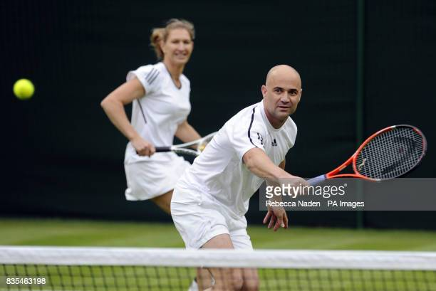 Andre Agassi in action on centre court with wife Steffi Graf in an exhibition match against Great Britain's Tim Henman and partner Kim Clijsters...