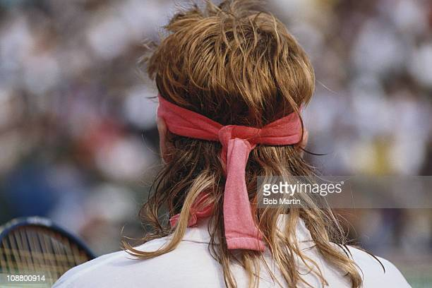 Andre Agassi of the United States wearing a toupee hairpiece during the Men's Singles final match against Andres Gomez during the French Open Tennis...