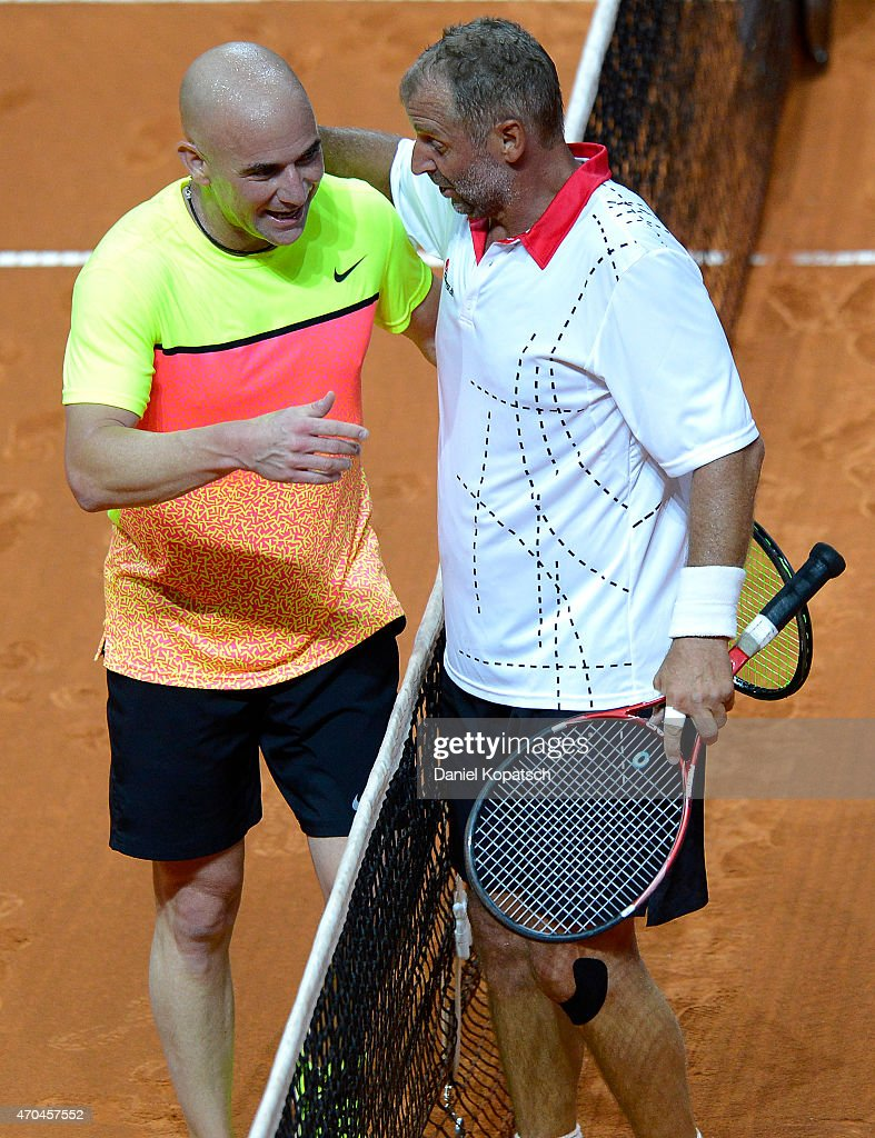 Andre Agassi of the USA and Thomas Muster of Austria shake hands during their Berenberg Classic match against on day one of the Porsche Tennis Grand...