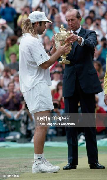 Andre Agassi of the USA is presented the men's singles trophy by the Duke of Kent after defeating Goran Ivanisevic of Croatia in five sets during the...