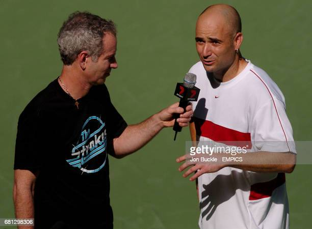 Andre Agassi of USA has a post match interview with tennis legend John McEnroe