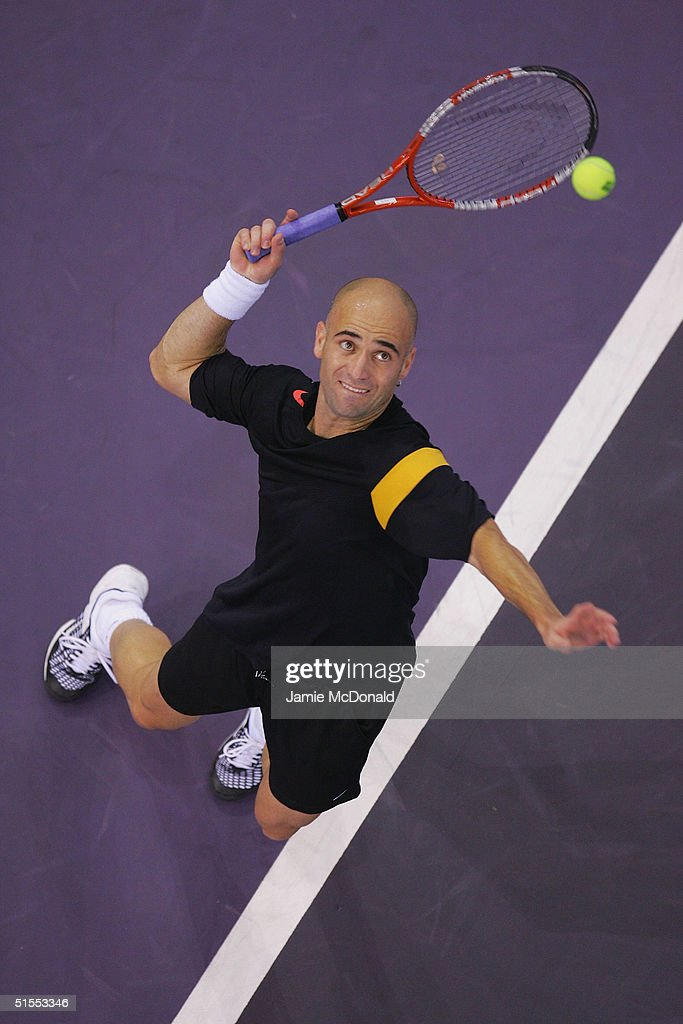 Andre Agassi of USA serves during his semi final match against Marat Safin of Russia during the ATP Madrid Masters at the Nuevo Rockodromo on October 23, 2004 in Madrid, Spain.