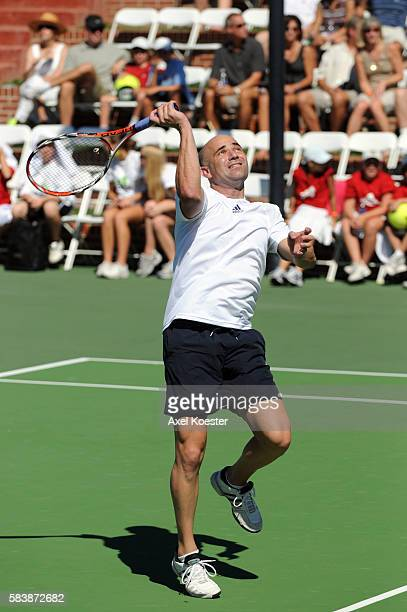 Andre Agassi participates in the Bryan Brothers' AllStar Tennis Smash doubling with Mike Bryan benefiting local and national charities at the...