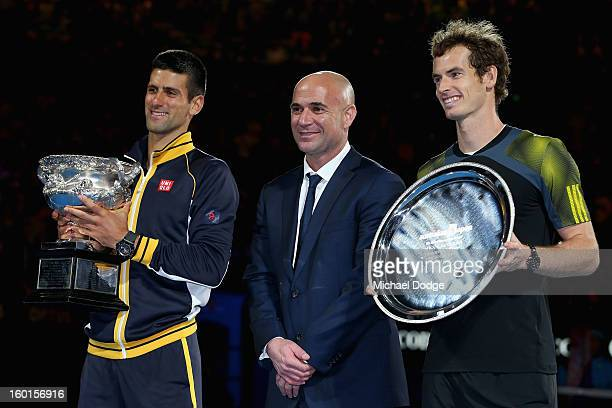 Andre Agassi poses with champion Novak Djokovic of Serbia and runner up Andy Murray of Great Britain after their men's final match during day...