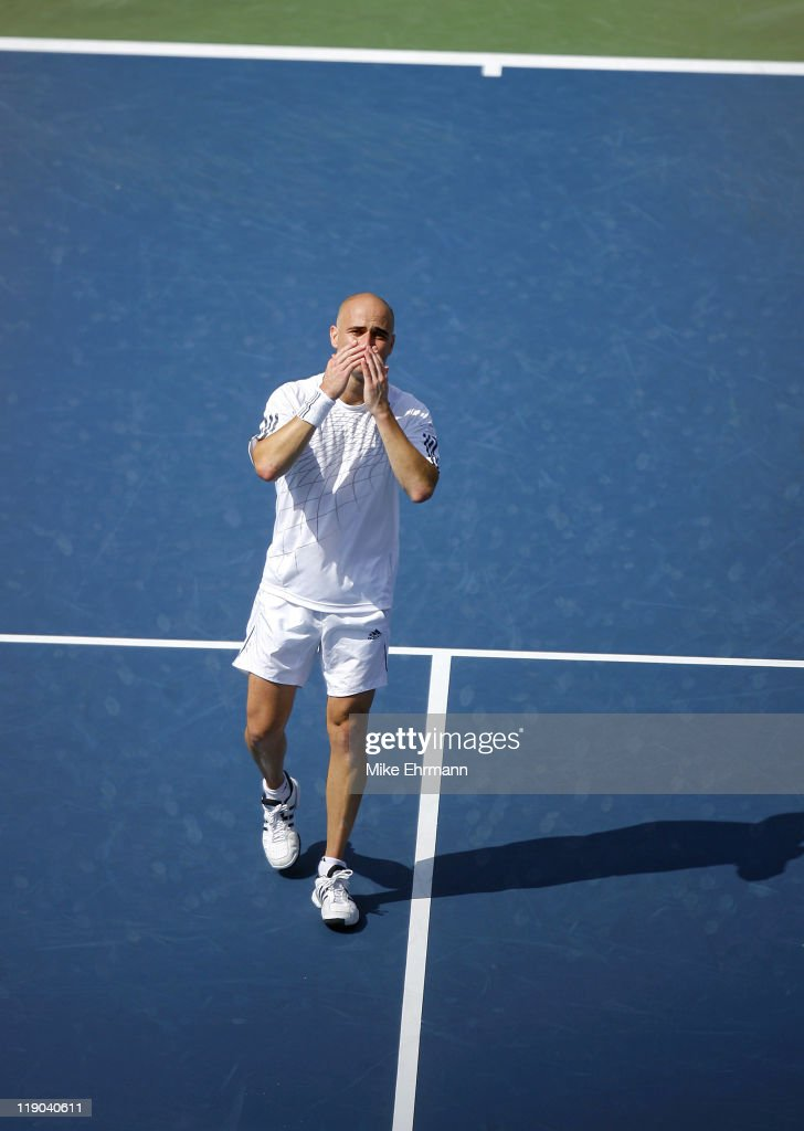 <a gi-track='captionPersonalityLinkClicked' href=/galleries/search?phrase=Andre+Agassi&family=editorial&specificpeople=157607 ng-click='$event.stopPropagation()'>Andre Agassi</a> reacts after losing his third round match against <a gi-track='captionPersonalityLinkClicked' href=/galleries/search?phrase=Benjamin+Becker&family=editorial&specificpeople=777311 ng-click='$event.stopPropagation()'>Benjamin Becker</a> at the 2006 US Open at the USTA Billie Jean King National Tennis Center in Flushing Meadows, Queens, New York, on September 3, 2006.