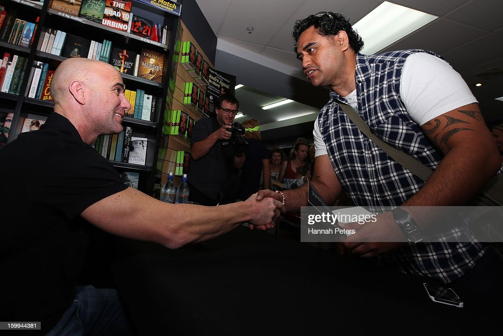 <a gi-track='captionPersonalityLinkClicked' href=/galleries/search?phrase=Andre+Agassi&family=editorial&specificpeople=157607 ng-click='$event.stopPropagation()'>Andre Agassi</a> signs copies of his autobiography, Open, at Paper Plus Newmarket on January 24, 2013 in Auckland, New Zealand.